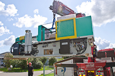 Arburg 570 injection moulding machine being hoisted