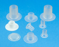Medico tube flanges and tube connector flanges for medical bags. PVC and plastic optimized for HF welding