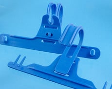Urine bag hangers in plastic