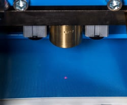 A laser pointer allows for precision alignment using the automatic eyelet machine